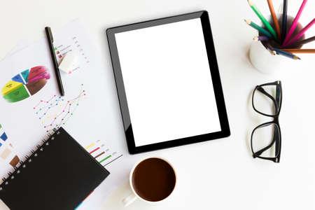 Foto de tablet on desk workspace in office background - Imagen libre de derechos