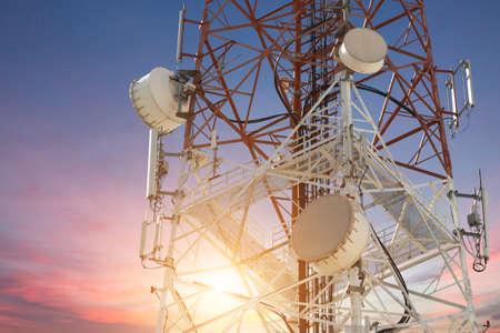 Photo pour Satellite dish telecom tower at sunset - image libre de droit