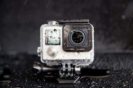 Foto de closeup water splash on extreme camera  in waterproof - Imagen libre de derechos