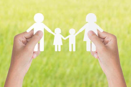 Foto de hand hold family model over green background - Imagen libre de derechos