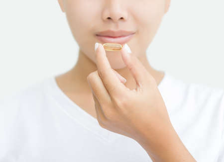 Photo pour close up woman taking vitamin capsule for healthy - image libre de droit