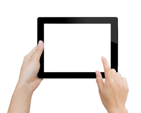 Foto de woman hand using mock up digital tablet isolated clipping patch in image data - Imagen libre de derechos