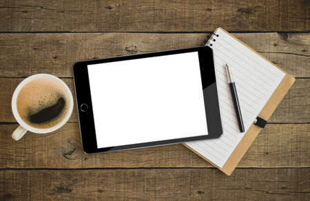 Photo for tablet on wood desk on top view - Royalty Free Image