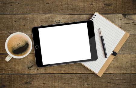 Foto de tablet on wood desk on top view - Imagen libre de derechos
