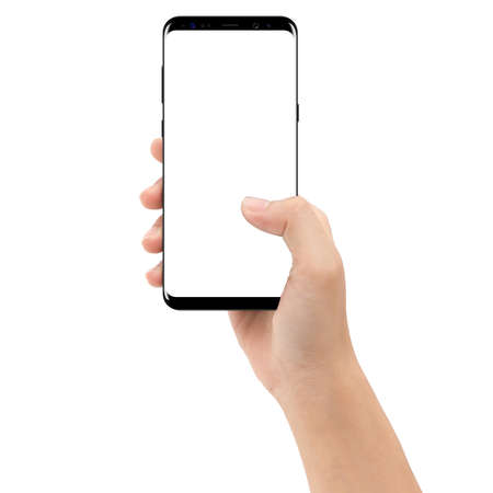 Foto de hand holding phone mobile isolated on white background clipping path inside - Imagen libre de derechos