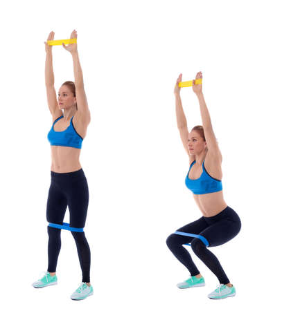 Photo pour Elastic band exercises executed with a professional trainer. - image libre de droit
