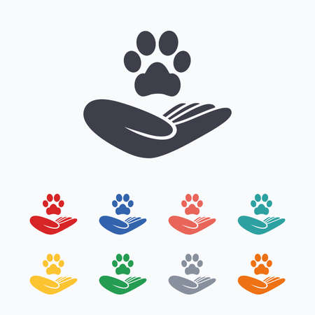 Ilustración de Shelter pets sign icon. Hand holds paw symbol. Animal protection. Colored flat icons on white background. - Imagen libre de derechos