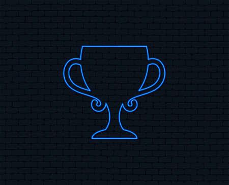 Ilustración de Neon light. Winner cup sign icon. Awarding of winners symbol. Trophy. Glowing graphic design. Brick wall. Vector - Imagen libre de derechos
