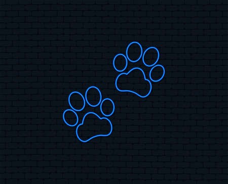 Ilustración de Neon light. Paw sign icon. Dog pets steps symbol. Glowing graphic design. Brick wall. - Imagen libre de derechos