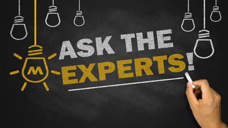 Foto de ask the experts on blackboard background - Imagen libre de derechos