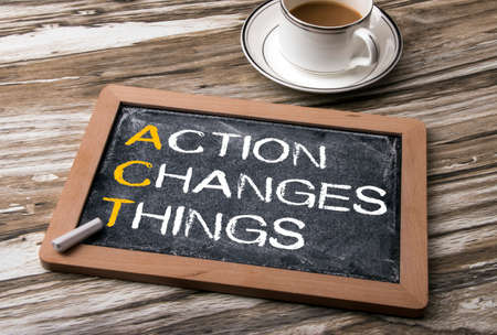 Photo pour the words of action changes things on blackboard - image libre de droit