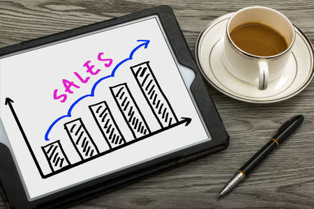 Foto de sales graph concept hand drawing on tablet pc - Imagen libre de derechos