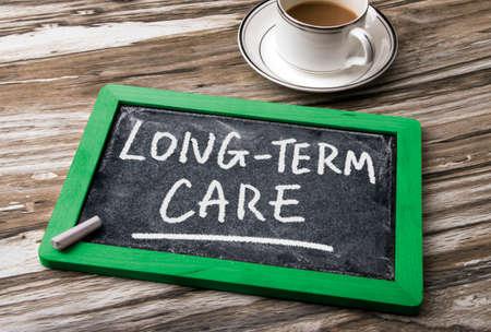Photo pour long-term care handwritten on blackboard - image libre de droit