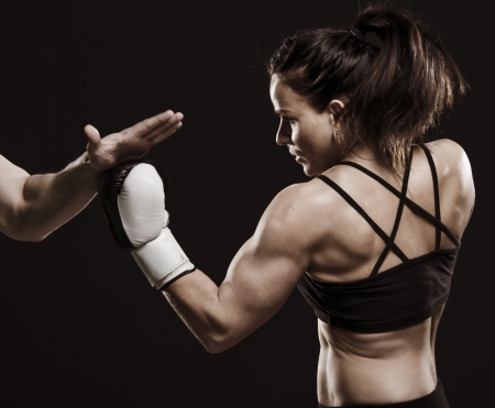 A studio shot of beautiful fitness woman training boxing