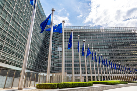 Photo for European flags in front of  headquarters of European commission in Brussels in summer day - Royalty Free Image