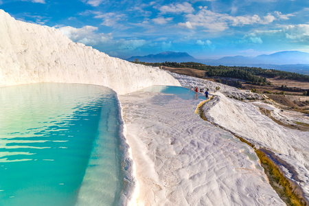 Photo for Travertine pools and terraces in Pamukkale, Turkey in a beautiful summer day - Royalty Free Image