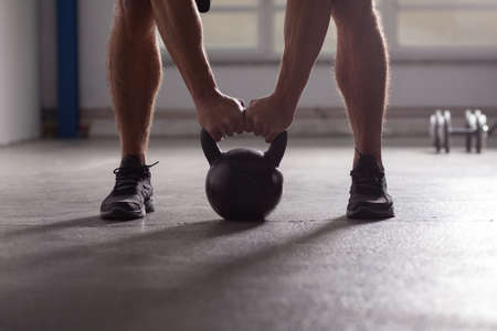 Photo for crossfit - kettlebell training backlit - Royalty Free Image