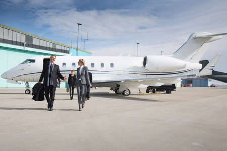 Photo for executive business team leaving corporate jet - Royalty Free Image