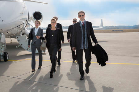 Foto de executive business team leaving corporate jet - Imagen libre de derechos