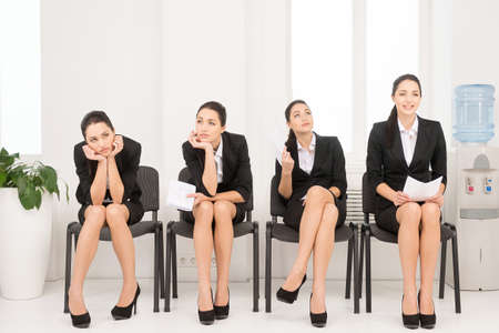 Photo pour Four different poses of one woman waiting for interview. Sitting in office on chair. - image libre de droit