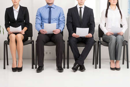 Photo for Four candidates competing for one position. Having CV in his hand - Royalty Free Image