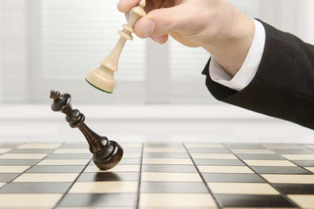 Photo for High key image of a Chess board. Checkmate by the black Pawn. - Royalty Free Image