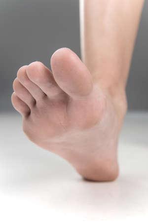 Women beautiful Foot stepping closeup. feet walking on floor with fingers closeup