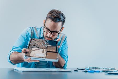 Foto für Technician examining laptop parts. Hardware. - Lizenzfreies Bild