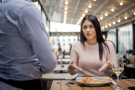 Photo for Portrait of woman complaining about food quality and taste in restaurant. - Royalty Free Image