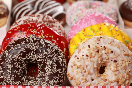 Photo for Collection of many colored donuts in a box - Royalty Free Image
