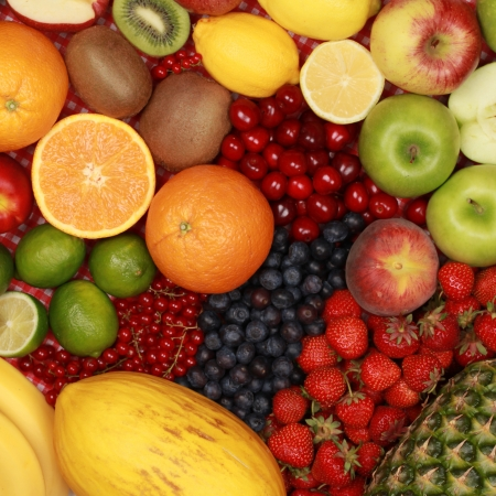 Fruit background with oranges, lemons, cherries, apples and strawberries