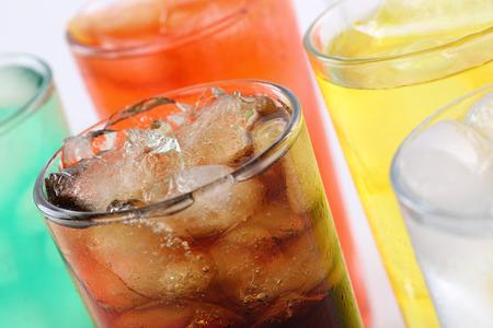 Foto de Colorful soda drinks with cola, soft drinks with ice cubes - Imagen libre de derechos