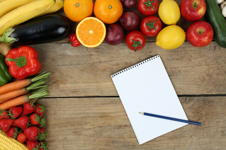 Shopping list with fruits and vegetables like oranges, apples and tomatoes