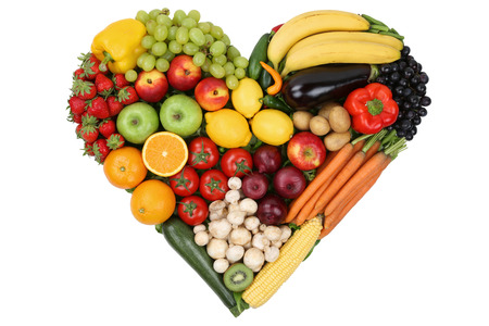 Photo for Fruits and vegetables forming heart love topic and healthy eating, isolated - Royalty Free Image