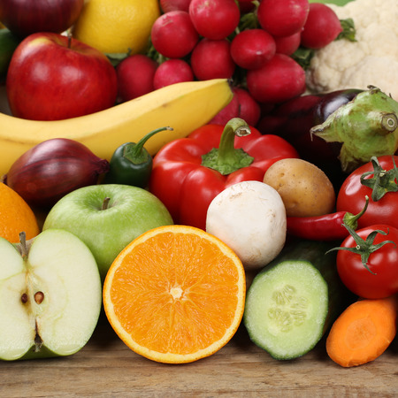 Healthy eating sliced fruits and vegetables like apples and oranges