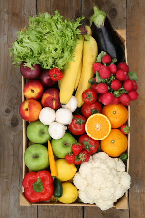 Photo pour Healthy eating shopping at market fruits and vegetables in box from above - image libre de droit