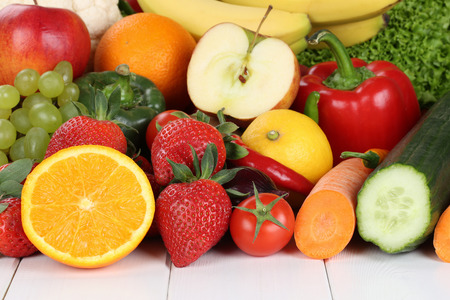 Fruits and vegetables like oranges, apple, tomatoes, banana, strawberry