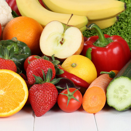 fresh fruits and vegetables like oranges, apple, tomatoes, banana, strawberry