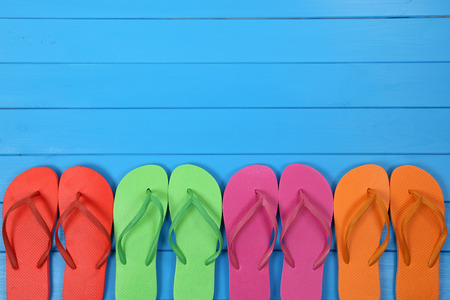 Photo pour Flip Flops sandals in summer on vacation, holidays with copyspace - image libre de droit