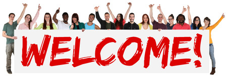 Foto de Welcome sign group of young multi ethnic people holding banner isolated - Imagen libre de derechos