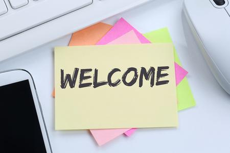 Foto de Welcome new employee colleague refugees refugee immigrants desk computer keyboard - Imagen libre de derechos