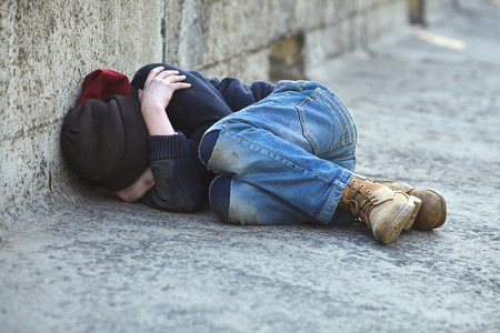 Photo for young homeless boy sleeping on the bridge, poverty, city, street - Royalty Free Image