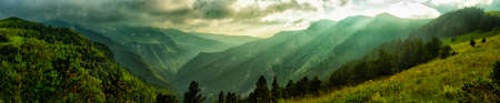Wooded mountains with canyons and peaks in a storm