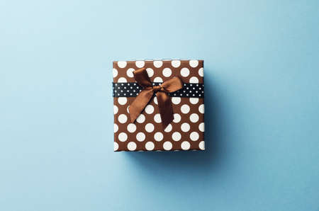 Photo for Christmas present box over blue background, above view. - Royalty Free Image