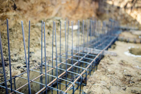 Photo for Foundation site of new building, details and reinforcements with steel bars and wire rod, preparing for cement pouring - Royalty Free Image