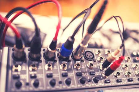 Foto de Audio and video jack cable connected at rear end of receiver, amplifier or music mixer at concert, party or festival. Soft effect on photo - Imagen libre de derechos