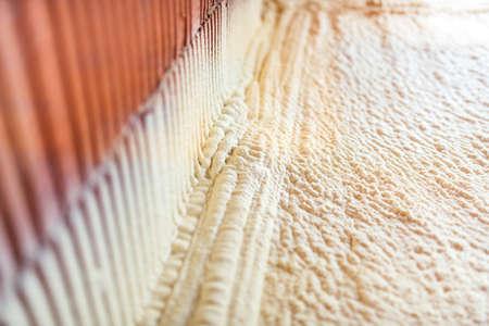 Foto de thermal and hidro insulation with spray foam at house construction site, - Imagen libre de derechos