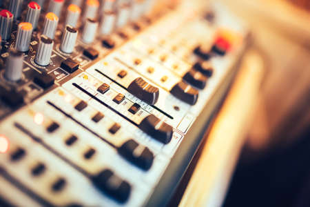 Photo for Close-up of music mixer button, setting volume. Music production mixer, adjustment tools - Royalty Free Image