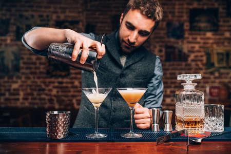 Foto de Barman creating professional cocktails. Details of alcoholic drinks and beverages at pub or bar - Imagen libre de derechos