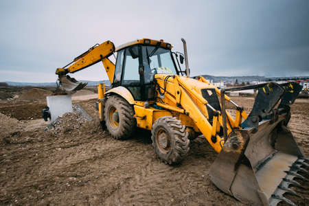 Photo pour close up details of massive working machinery, industrial backhoe loader with excavator on construction site - image libre de droit